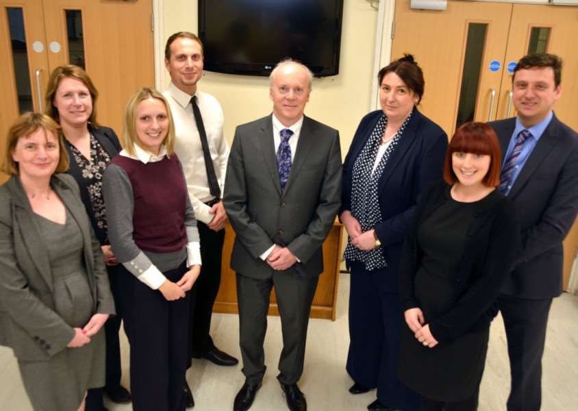 Laurence Reilly, (centre), Executive Head Teacher of the South Lincolnshire Academies Trust, with Tracey Berry, Karen Joel, Nicola Hall-Rushton, Liz Dilley, Brett Sinclair, Rebecca Le Caplain, Daisy Ivatt and James Hind at Spalding Academy. Photo by Tim Wilson. SG110117-102TW.