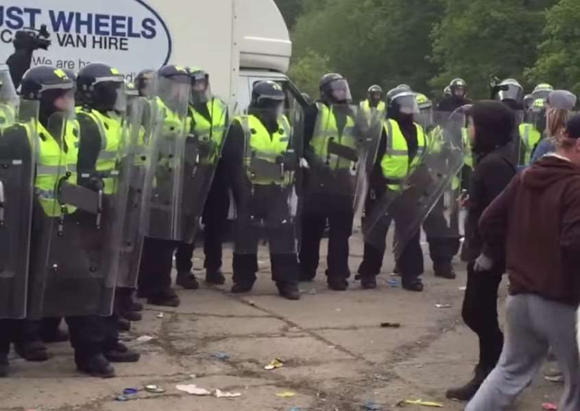 Police and illegal ravers at Twyford Wood last year.