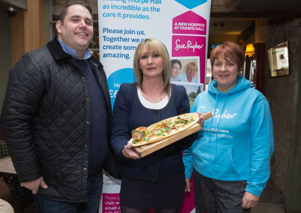 Knead Pubs executive chef Nick Buttress, competition winner Amanda Willson and hospice fundraiser Jo Marriott with the winning pizza. For every pizza sold, �1 will be donated to the Thorpe Hall Hospice Appeal.