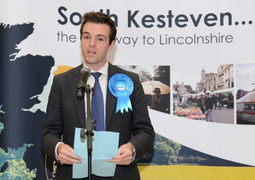 MP Nick Boles' election agent Kelham Cooke reads out a message from Mr Boles after his victory as the re-elected MP could not be at the count.