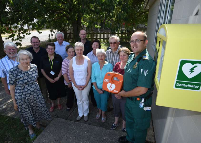 Rob Birkin, community resuscitation trainer for the east Midlands Ambulance service with residents and sponsors at Essendine Village Hall where they have their own defib machine EMN-151208-213217009