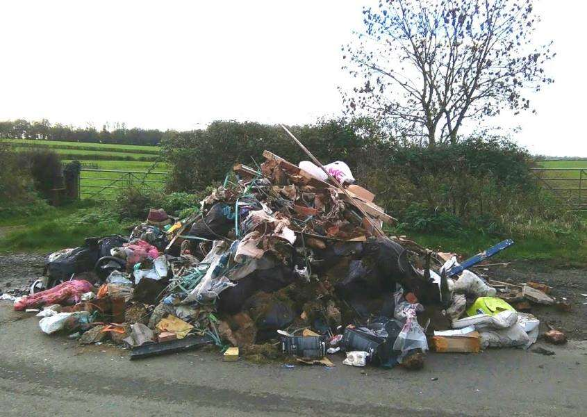 A huge pile of household and building waste was discovered dumped in Little Lawford Lane NNL-151117-130307001