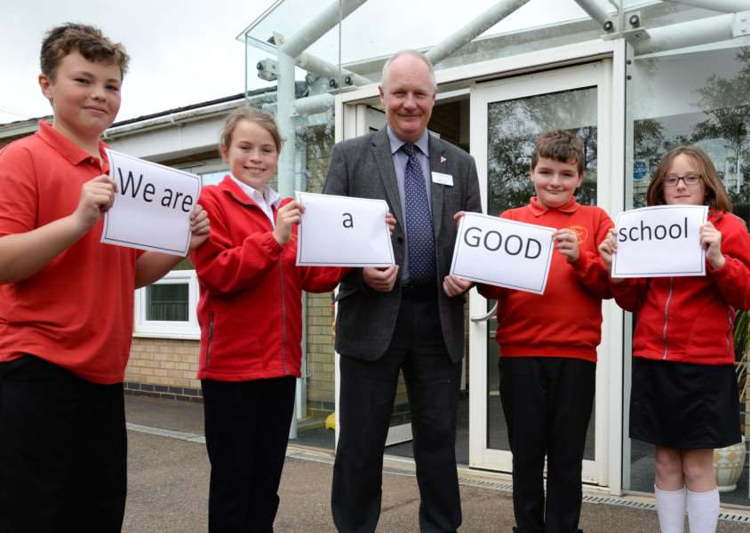 Uppingham CE Primay School headteacher Iain Peden celebrate a good Ofsted report with pupils Ali Hall, Ella Cowling, Curtis Hull, and Chloe Lisher. Photo: Alan Walters MSMP-11-05-15-aw001 EMN-151205-145556001