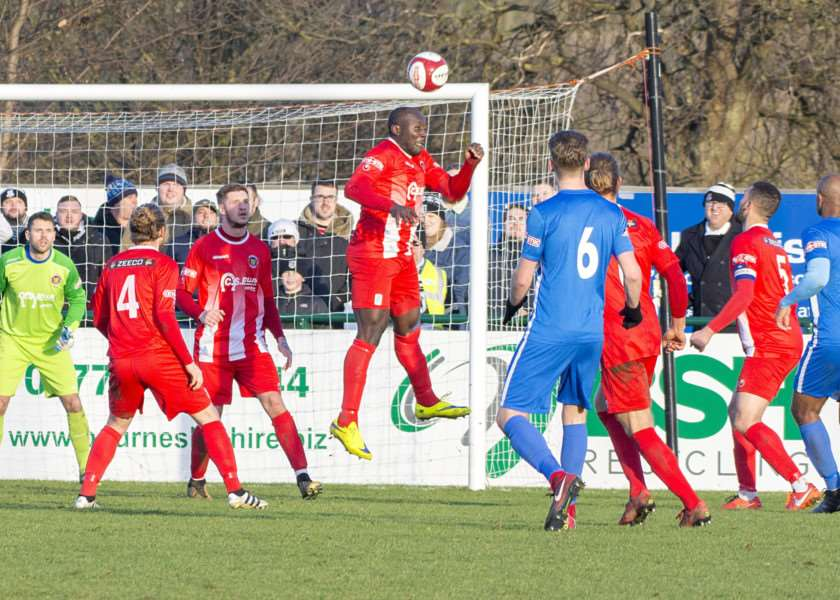 Henry Eze heads clear for Stamford in the Boxing Day derby victory over Corby Town.