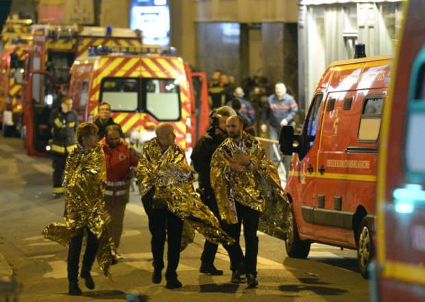 People are being evacuated on rue Oberkampf near the Bataclan concert hall in central Paris. Picture: AFP/Getty Images