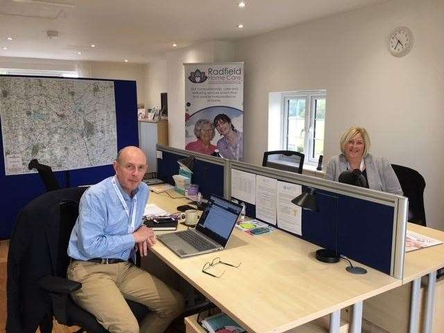 James Beech, owner with Karen Nash, care manager, using the Access Care Management system. (28407461)
