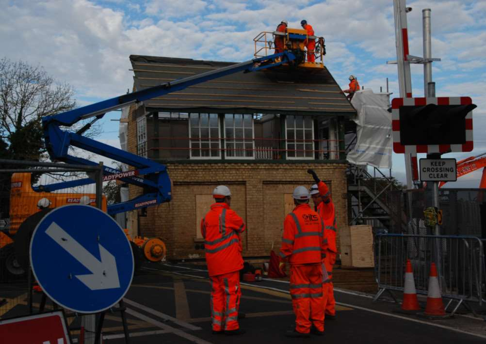 Demolition of the Deeping St James signal box.'Photo courtesy of John McGowan. EMN-141027-094153001