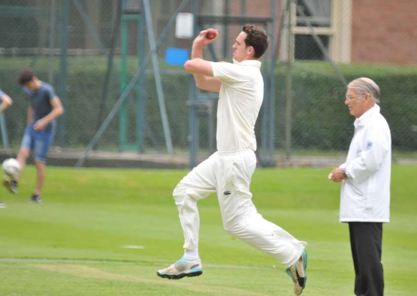 Rob Bentley bowling for Bourne against Boston. Photo: Tim Wilson.