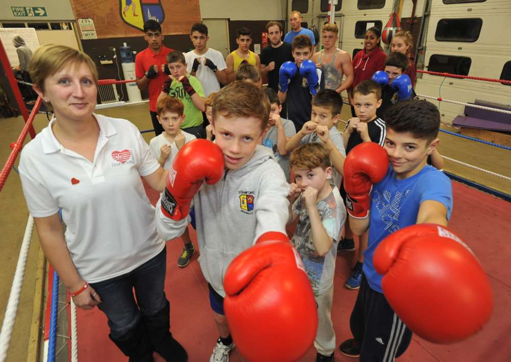 Stamford Boxing Club boys who raised money for Dosh4Defibs. They are pictured with charity representative Dannii Vincent.
