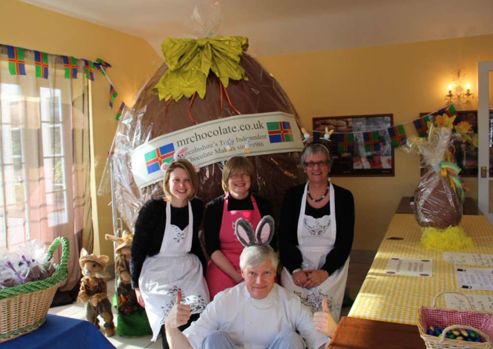 Shelley Seston, Phara Hansen and Linda Miller with Jan Hansen and his giant chocolate egg. Jan, from Folkingham, raised more than ?1,700 for St Barnabus Lincolnshire Hospice. EMN-150704-144428001