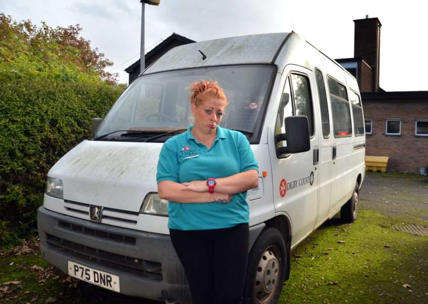Staff member Emma Wray outside Digby Court Care Home in Bourne with the old minibus that is in need of a replacement. Photo by Tim Wilson.