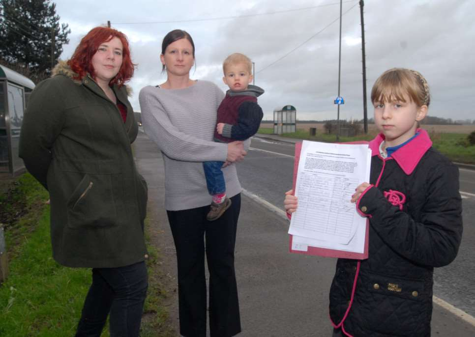 Clare White and Sam Abbott campaigning for a pedestrian crossing at Thurlby and Northorpe in January 2014. Sam Abbott, left, and Clare White, with her children Tia, 10, and Alfie, 23 months.