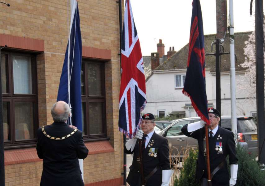 Coun Robert Clark, ex-chairman of South Holland District Council, raises the Commonwealth flag outside the council's offices in Spalding in 2014. Photo: SG100314-114NG.