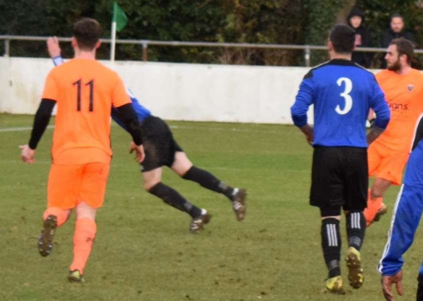 Ben Porter (right) scores the first of his three goals for Blackstones in their victory over Burton Park Wanderers on Saturday.