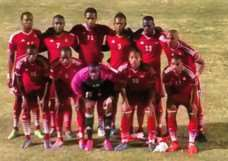 Ryan Robbins and his St Kitts and Nevis team mates before kick off on Monday night EMN-150324-122815001