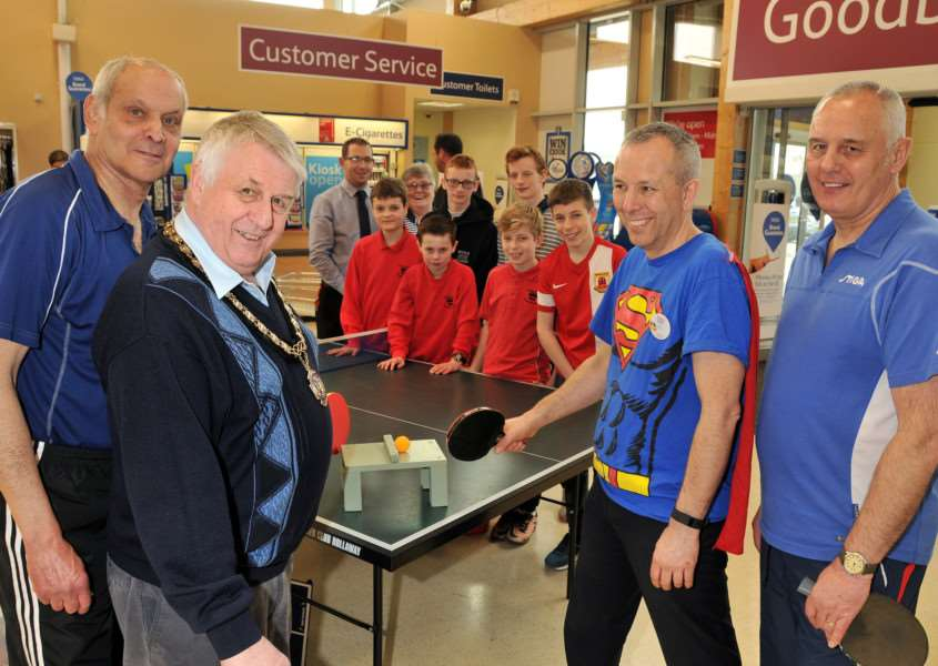 Joe Beadle and Bourne mayor Philip Knowles (left), with store manager Mark Porter, Colin Vertigan and students from both Bourne Academy and Bourne Grammar School put on a table tennis demonstration charity fundraiser at Tesco Superstore, Bourne. Photo by Tim Wilson.