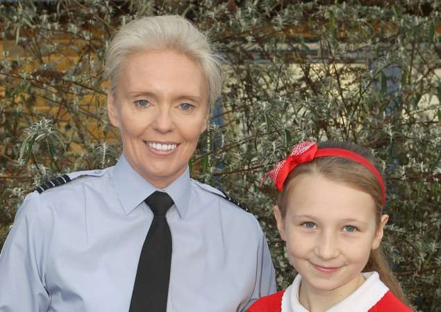 RAF Wittering Wing Commander Lizzy Nicholl with Wittering Primary School pupil Ellie-May Thompson, who deisnged the base's 2015 Christmas card design. EMN-141215-150903001