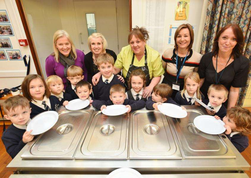 South Witham county primary school KS1 pupils at the opening of their new kitchen facilities with guests and members of staff EMN-160701-232441009