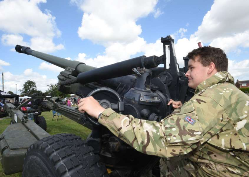Armed Forces Day event at Market Deeping. Alex Dannells-Myers from the 115 Peterborough ATC with the Howitzer 70 gun EMN-150628-202418009