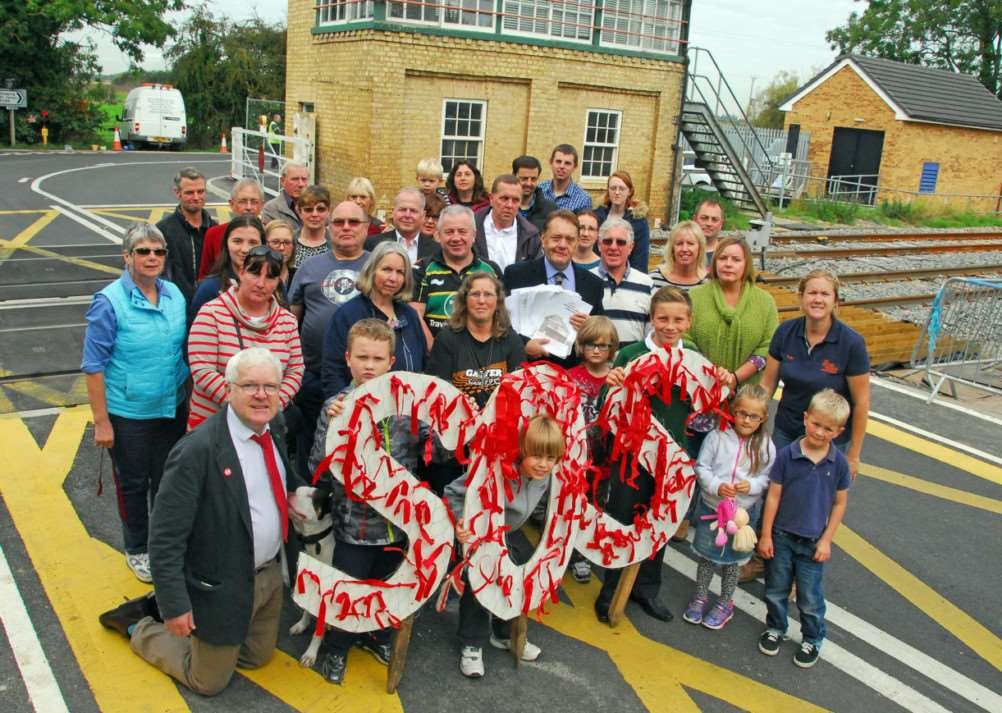 Signal box red ribbon protest Deeping St James'All with MP John Hayes centre ANL-140928-091504009