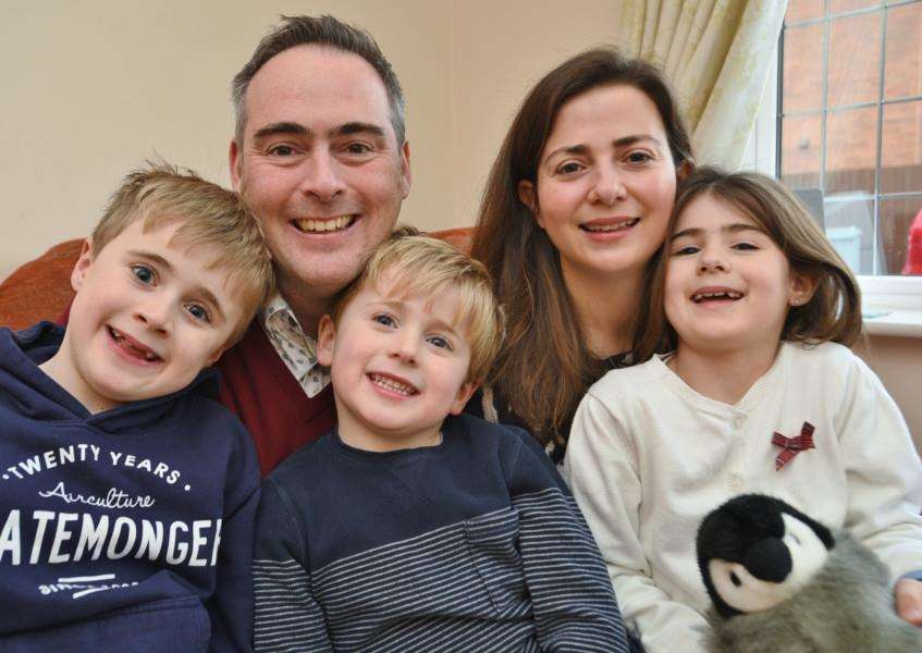 Bourne parents Owen and Anna Rogers with their children Lily (7) Ben (9) and Sam (5). They have set up an MD awareness charity EMN-160901-193020009