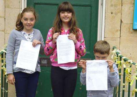 Sian (11), Rhiannon (13) and Rhys Morgan Plowright (seven) with their letters to Michelle Obama