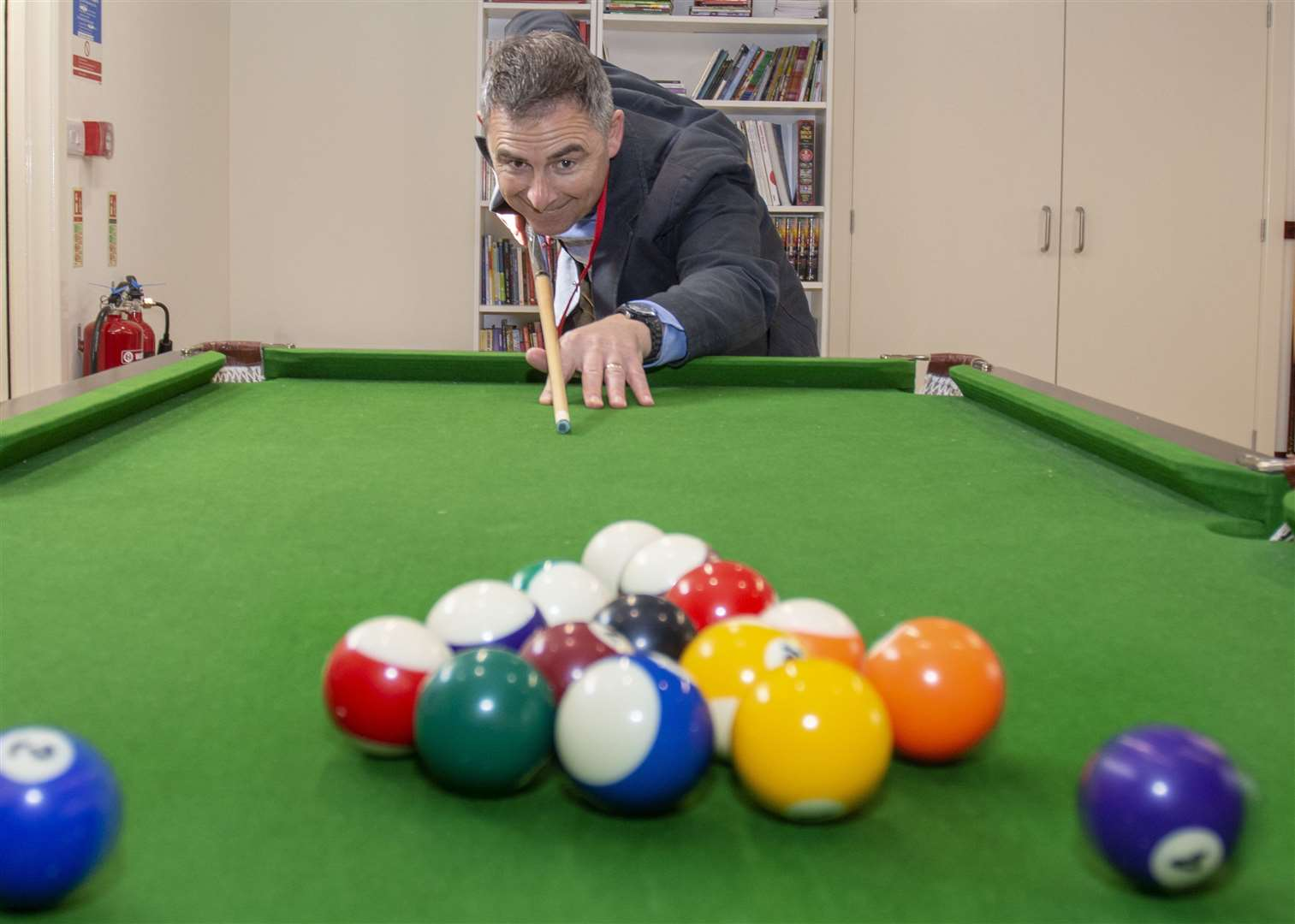 The Rev Martyn Taylor uses the pool table in The Zone (10181098)