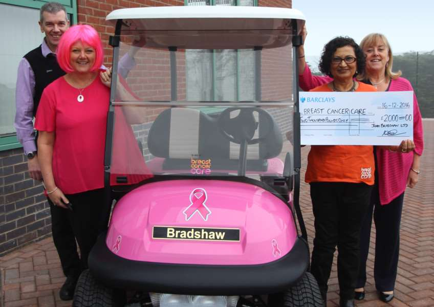 Cheque presentation by Bradshaw MD Drew Bradshaw and Bradshaw employees to Breast Cancer Care representative Jayshree Wadher in front of a pink golf buggy, which has been used at golf clubs to raise �2,000