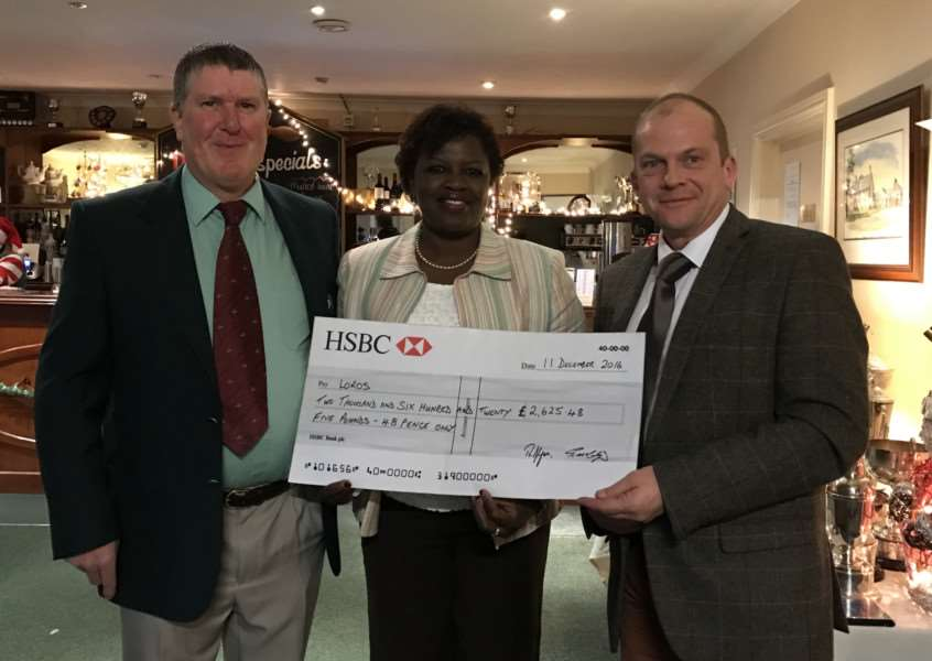 Captain Deggie Palmer, lady captain Ngoneh Dickinson and Loros chief executive John Knight
