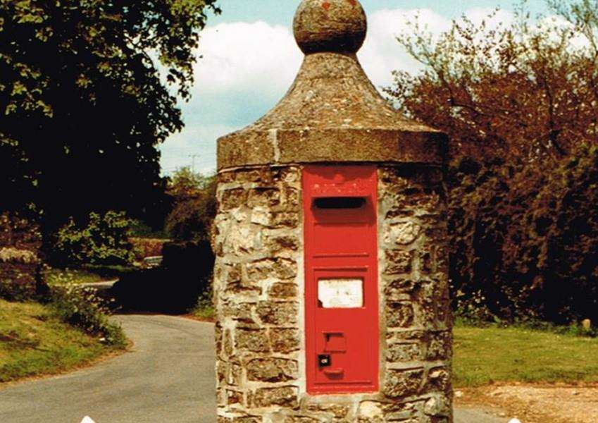 "An 1870s pillar mounted wall box as new commitments to preserve the ""character and heritage"" of the country's post boxes have been set out by Royal Mail and government agency Historic England."