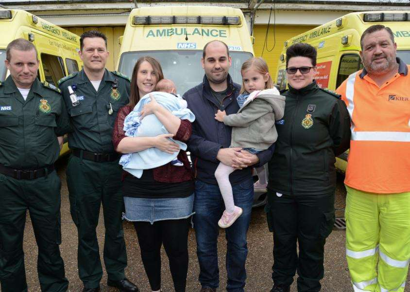 From left, Paramedic James Olgesby, Technician Philip Lane, Sarah Anderton with baby Arlo, Gareth Barrett and four-year-old Emily, emergency call taker Lucy Channer and Simon Greeves, gritter from Kier.
