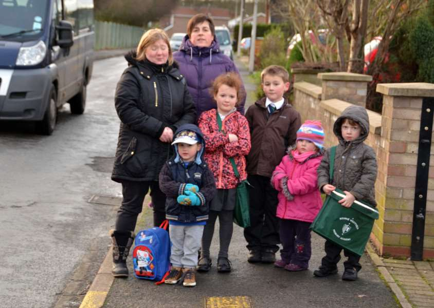 A petition calling for a one-way system and zig-zag lines outside Bourne Westfield Primary Academy has been handed in by Jenny Pace (left) pictured with Bourne town councillor Gillian Tordoff and youngsters Timothy Pace,Tiana and Kaylan Carter, Sarah and William Tordoff. Photo by Tim Wilson.