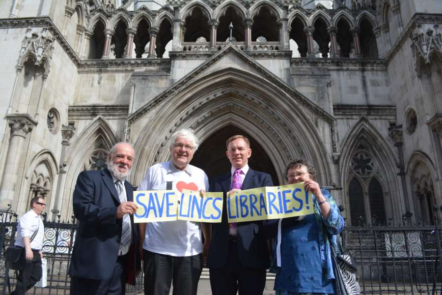 Library campaigners outside the High Court in London. From left, leader of the Labour group at Lincolnshire County Council John Hough, Labour county councillor for Deeping St James Phil Dilks, Labour's shadow minister for libraries Chris Bryant MP and Lesley Hough of Save Lincolnshire Libraries. EMN-150722-102523001