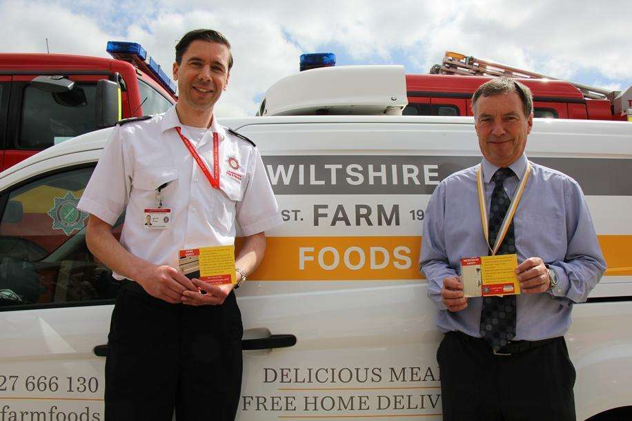 Lincolnshire Fire and Rescue's James Baker with Wiltshire Farm Foods operations manager Paul Dalton