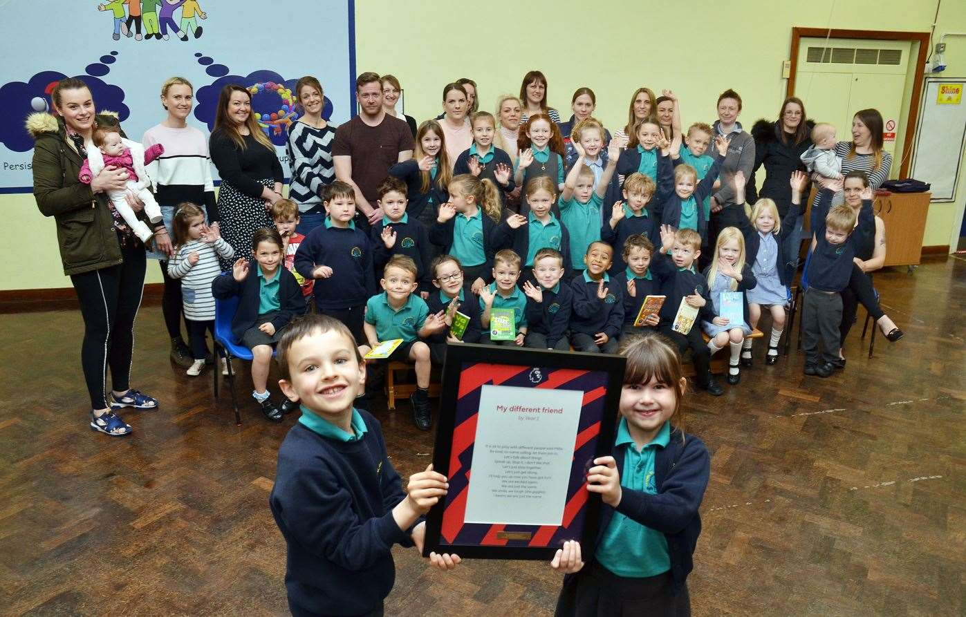 Deeping St James Pri sch Yr 1 won national poetry compPupils staff and parents, Nathan and Eleanor hold the award (8172539)