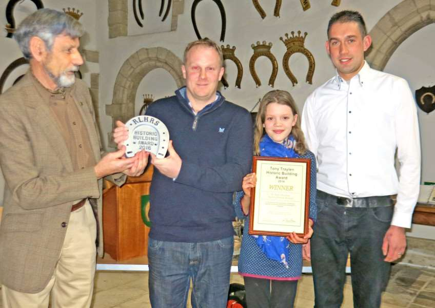 Tim Clough presents the Tony Traylen Built Environment Award plaque and certificate for The Barn, South Luffenham to owner Nick Bellamy together with daughter Tasha, and Ian Cleminson of C & F Building Services. 'All photos: Robert Ovens