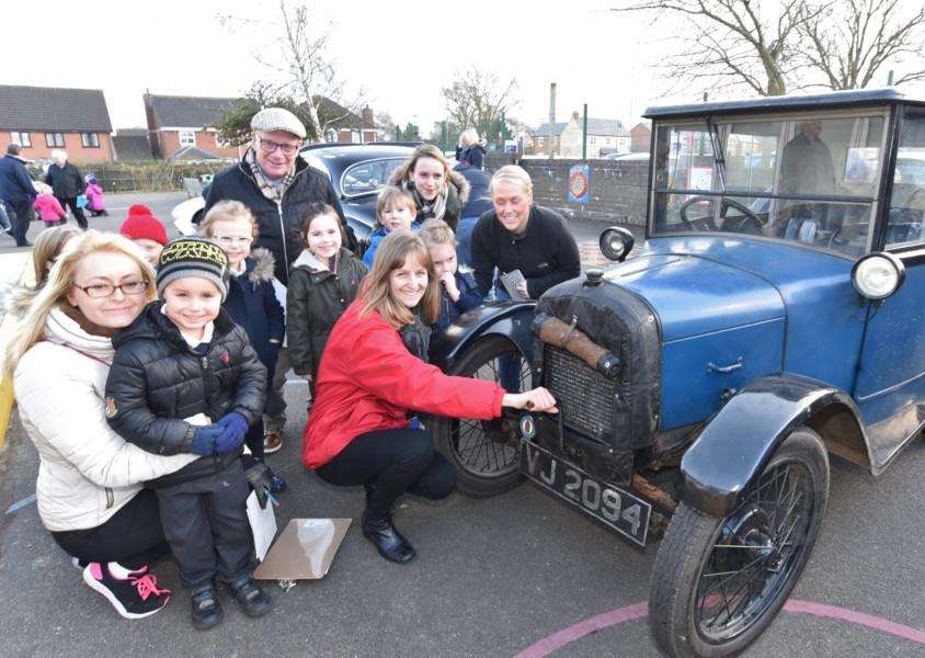 Malcolm Sargent Primary School teacher Kerry Thomson, pupils and parents look at one the vehicles on show