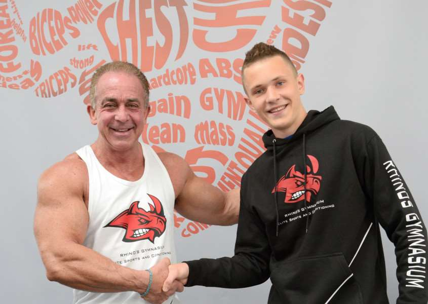 New College Stamford's Graphic Design student Kacper Trela presents wall mural to Nick Swann ' owner of Rhinos Gym. EMN-160629-160306001