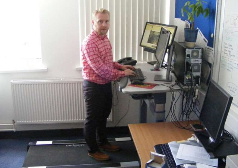Dr Mark Tully on his treadmill desk at work in Belfast's Queen's University.