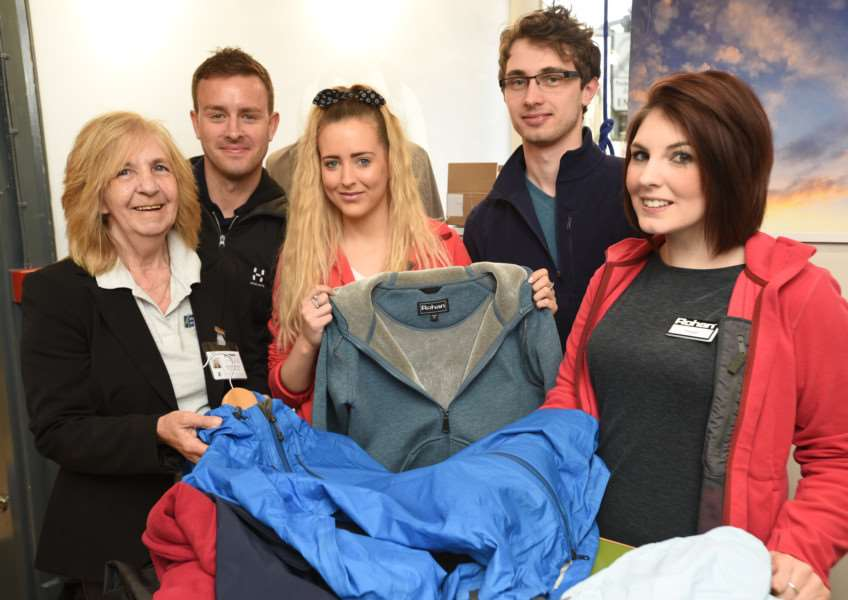 Sandra Barton and Dan Wallace from Endeavour with Sam Brigstock, Dee Phillips and Megan Parkin from Rohan store at Stamford with donated outdoor wear. EMN-150429-172812009