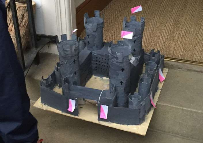 A papier mache castle left on the wrong doorstep in Barnack Road, Stamford. Names on the bottom are Scarlett Todd and Grace Kendall. EMN-151022-132838001
