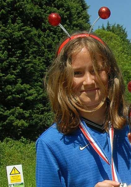 Maddy Orford with her medal from Bourne Rotary Club's 'Run in the Woods' at Bourne Woods in 2009. SG310509-326NG.