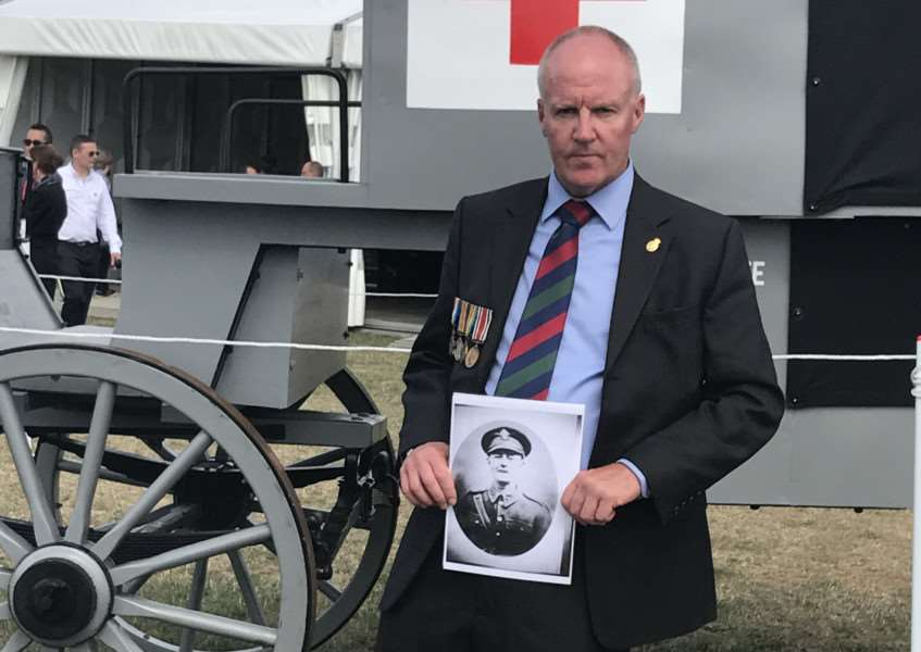 Andrew Brown with his grandfather's medals at the commemoration event