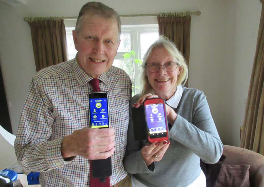 Russ Horne and Jan Warren pictured with the new Rutland Neighbourhood Watch app EMN-161121-143432001