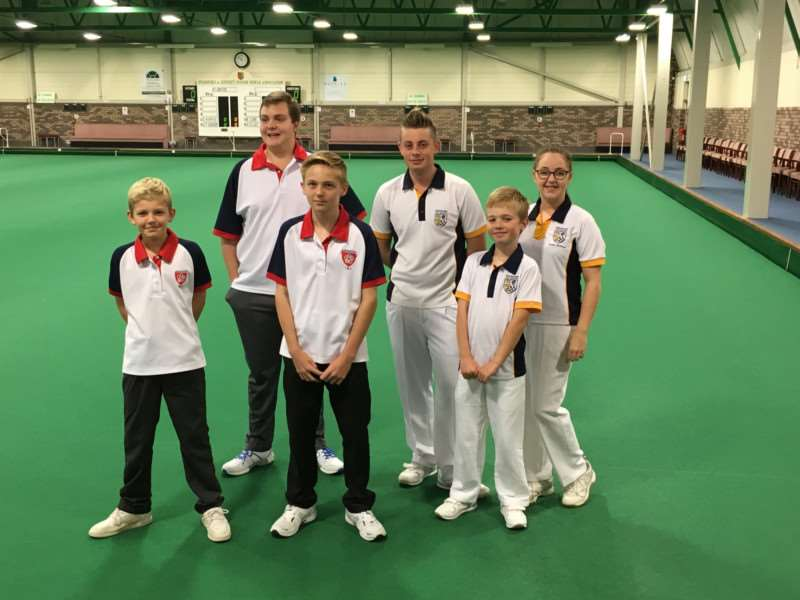 Stamford bowlers Jay Travis-Jenner (fourth from the left), Owen Aspinall and Helen Holroyd with their Leicester opponents.