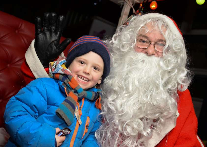 Oakham Late Night Shopping. Sam Payne with Santa. Photo: Alan Walters MSMP-08-12-14-aw007 EMN-141012-104141001