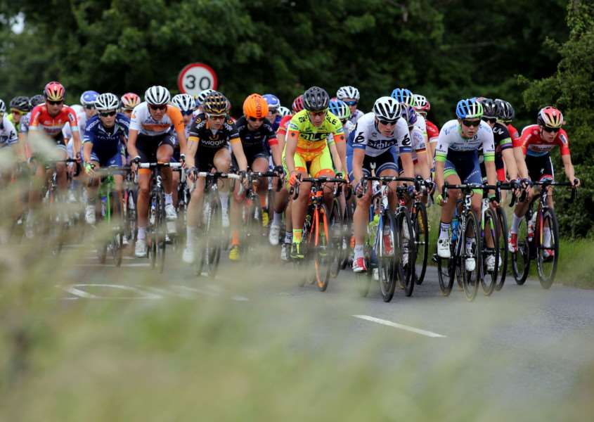 The Peloton passes through Forward Green in Suffolk during stage one of the Women's Tour of Britain. PRESS ASSOCIATION Photo. Picture date: Wednesday June 17, 2015. See PA story CYCLING Britain. Photo credit should read: Chris Radburn/PA Wire EMN-150617-164744001