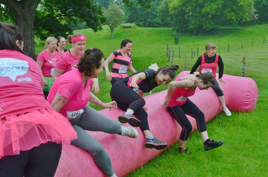 Runners in the Race for Life Pretty Muddy event at Burghley Park. EMN-160406-203702009
