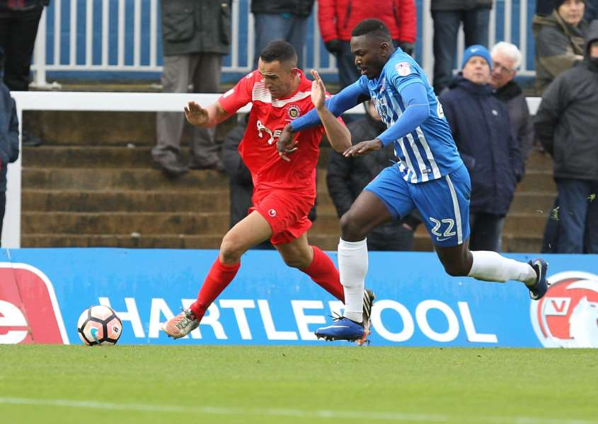 Kern Miller powers past Hartlepool's Toto Nsiala - Pic by: Richard Parkes EMN-160711-101734001