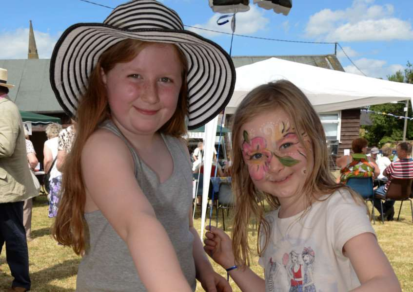 Caldecott summer fete. Elizabeth and Abby Marlow search for Minions. Photo: Alan Walters MSMP-05-07-15-aw002 EMN-150607-112727001